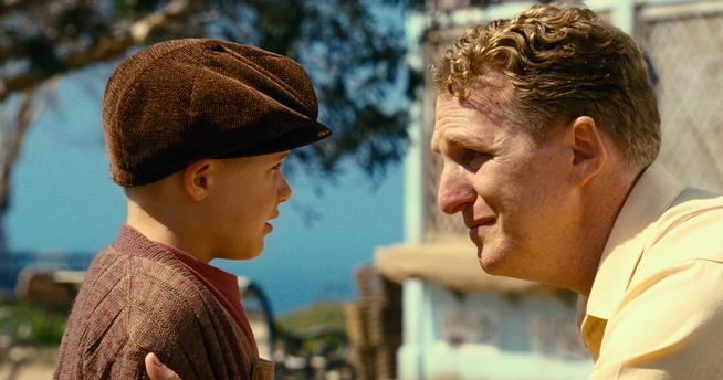 "This image released by Open Road Films shows Jakob Salvati, left, and Michael Rapaport in a scene from :Little Boy."" (Andrew Cadelago/Open Road Films via AP)"